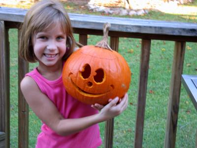 katie proudly displays her creation